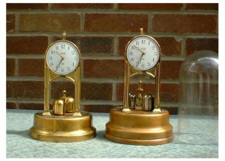 Two Tiffany clocks under domes