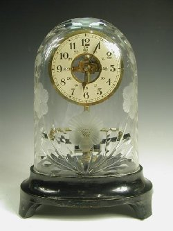 Bulle clock under cut glass dome
