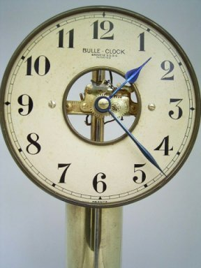 Close up of Bulle clock showing dial and movement